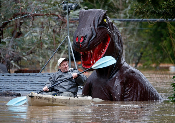 Rich Willson paddles through the miniature golf course in Guerneville, California, after the Russian River flooded Tuesday, Feb. 27, 2019.