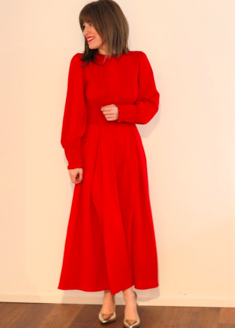 """Promising review: """"This red dress is thick yet has a beautiful drape to it. The sleeves are lantern-shaped and have a cute ruffle detail on the edge. The pintucks in the front and back are placed in the perfect spot to accentuate the waist. The dress fits like a glove. It is a bit longer on me than the model (I am 5'2"""" for reference). A perfect dress for Valentine's Day or the holidays!"""" —ruth maldonadoGet it from Amazon for $31.99+ (available in sizes XS–XL and in 10 colors)."""