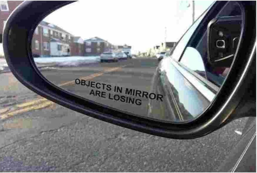 """sticker on side mirror that says """"objects in the mirror are losing"""""""