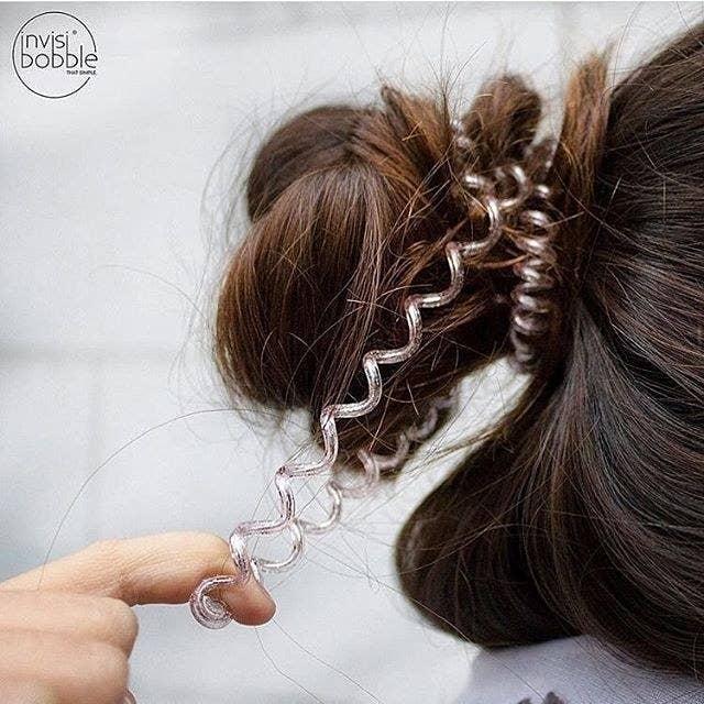 coiled hair tie in bun