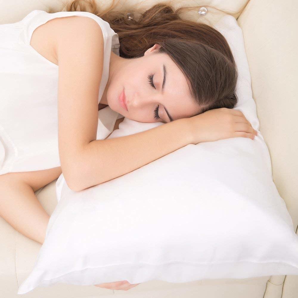 model sleeps on silk pillowcase