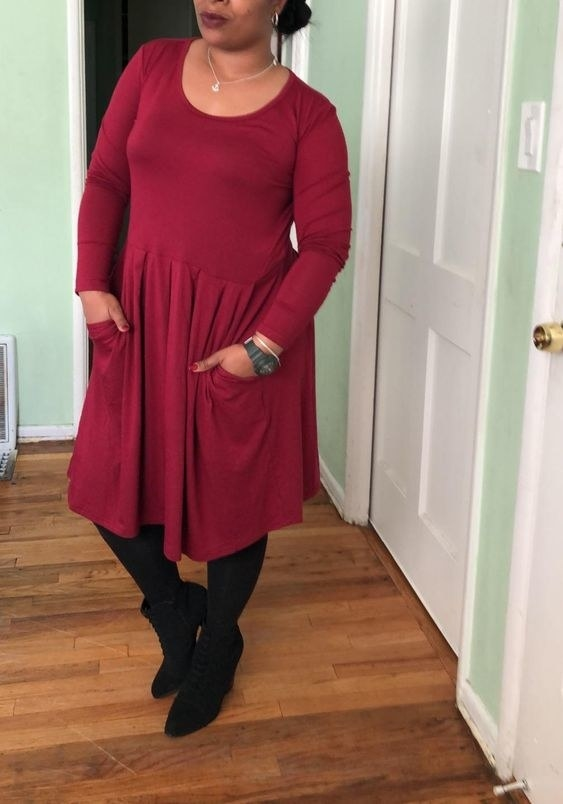 A long-sleeve pleated dress with pockets, because nothing sparks more joy than a dress with pockets. Let's get a hip, hip hooray for built-in hand warmers!
