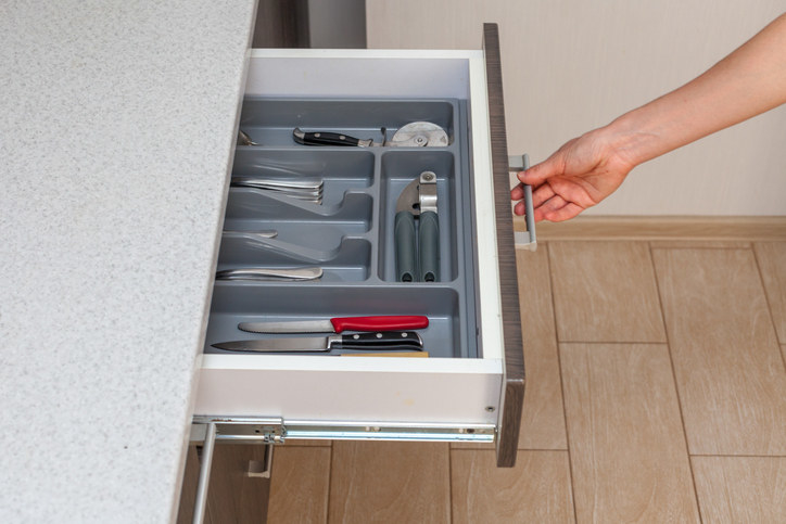 """If you lack drawer space in your kitchen, store your cutlery upright in tubes in your dish cupboard,"" says Kondo. ""If you store cutlery and small kitchen utensils in drawers, use dividers or shallow boxes to organize them."""