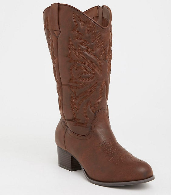 """Promising review: """"I love these boots! I've always wanted traditional style cowboy boots but all of them have been far too narrow and uncomfortable. These are so comfortable. I love how the calves have room for my jeans. The color is dark and rich and the stitching quality is awesome! Don't look back; get them now!!!"""" —KIMBERLY3350Get them from Torrid for $56.17 (originally $74.90, available in sizes 7–11)."""