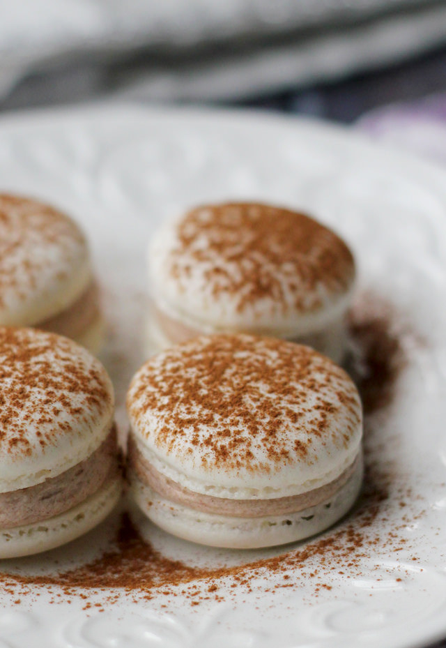 Snickerdoodle Macarons  -  These macarons, filled with a cinnamon sugar buttercream, are the perfect mashup of snickerdoodles and macarons. Get the recipe .