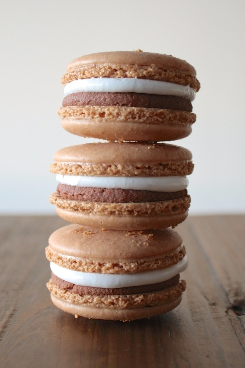 S'mores Macarons  -  These macarons use a combination of almond flour and ground graham crackers to make the shells, and get filled with both chocolate ganache and marshmallow fluff. Get the recipe .