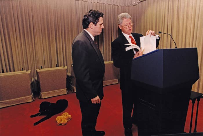 President Bill Clinton and Director of Speechwriting Michael Waldman go over the State of the Union speech at the White House on Jan. 26, 1998, as first dog Buddy lies in the background.