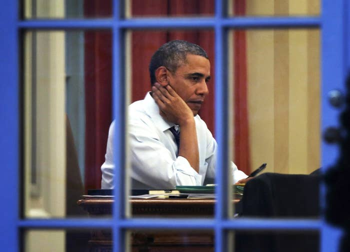 President Barack Obama works on a draft of his State of the Union address in the Oval Office on Jan. 27, 2014.