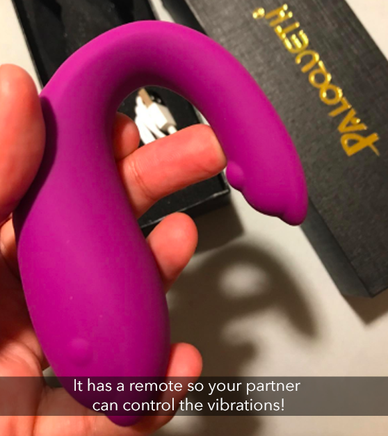 "A reviewer holding the sex toy with the caption ""It has a remote so your partner can control the vibrations!"""
