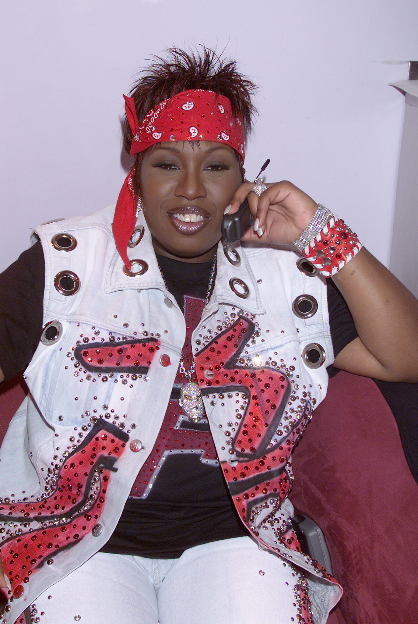 Missy Elliot talking on her flip phone that had a pull-up antenna.