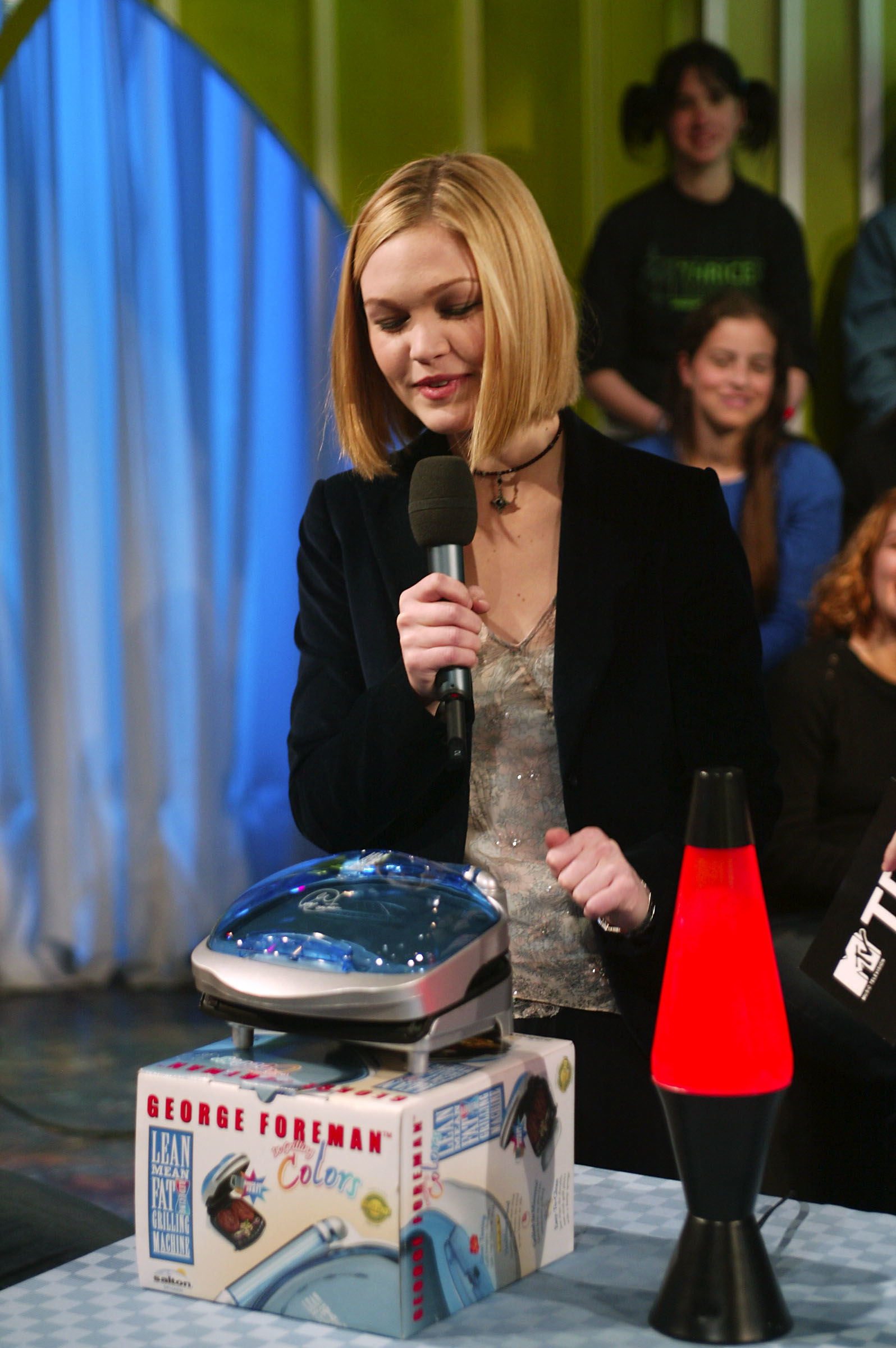 Julia Styles showing off the latest lava lamps and a new George Foreman Grill.