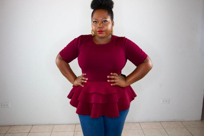 reviewer wears short sleeve peplum top