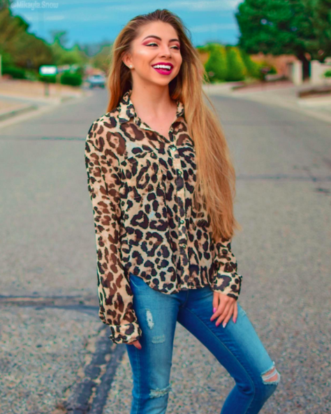 reviewer wears leopard button down that is somewhat sheer