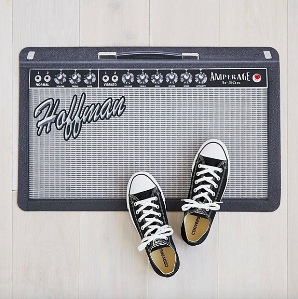 welcome mat that looks like a guitar amp with the family's last name as the brand log