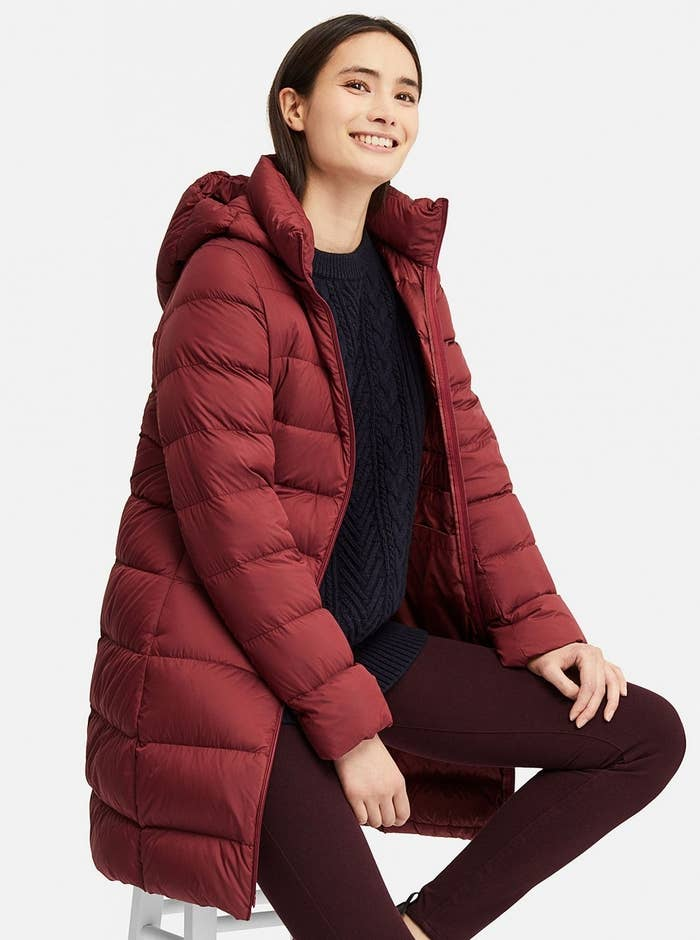 """Psst, the hood is removable! Promising review: """"This ultra light down jacket is perfect for every day use and travel. It's very warm and light weight, and I love how it can be packed into a small pouch so it won't take up too much space in a suitcase or bag. Plus, the slight a-line design is a great look."""" —connieGet it from Uniqlo for $99.90 (available in sizes XXS-XXL and in five colors)."""