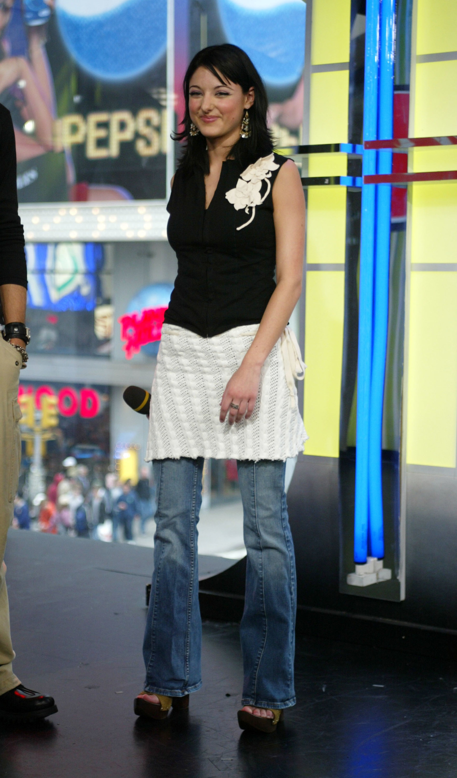 Stacie Orrico in this skirt over jeans.