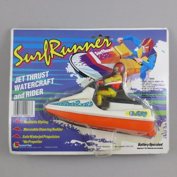 A orange and white jet ski toy in its package