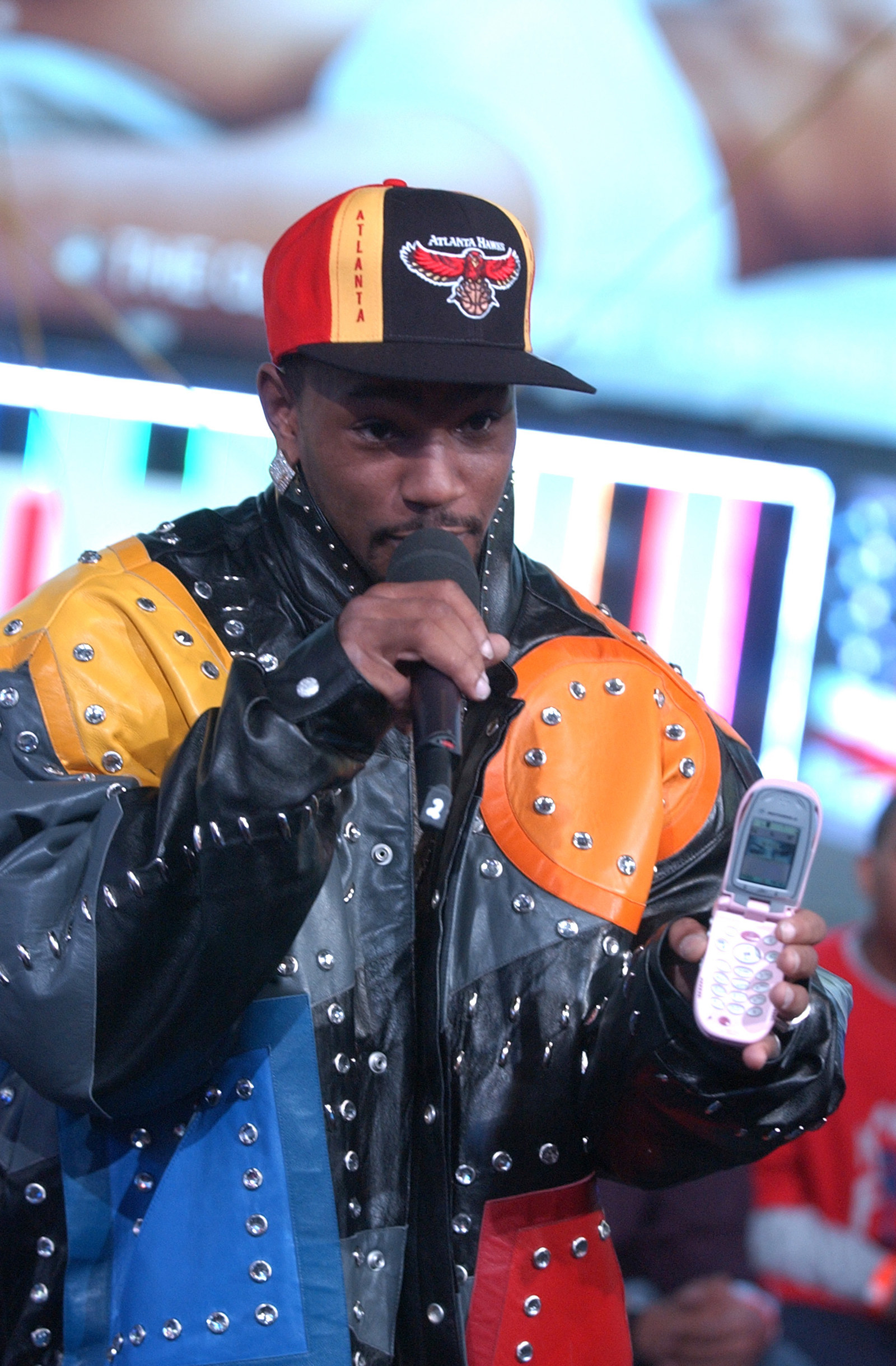 Also Cam'ron showing off his pink mobile device.