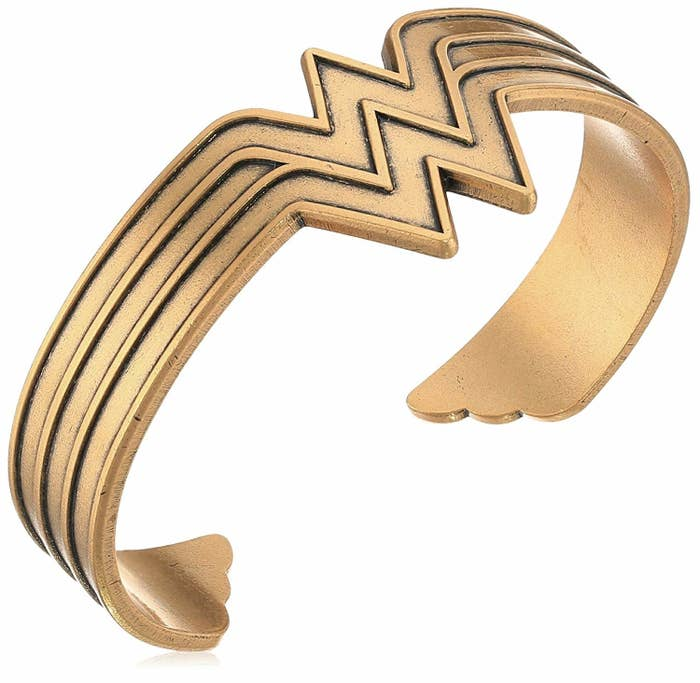 """I got this beauty for Christmas and I'm totally in love! It's easy to squeeze it to the right size and it instantly makes every outfit a million times more awesome!!!Promising reviews (I had to include two because they're making me emotional!):""""I LOVE this cuff bracelet. I've been fighting and beating chronic lyme disease and co-infections since the '70s. I AM Wonder Woman!"""" —LadySelene""""This picture doesn't show the true beauty of this Wonder Woman cuff. It's so nice and served as the PERFECT master's degree graduation gift for a friend who works full time, is a mom, and goes to school."""" —EMCGet it from Amazon for $31.99+ (available in two colors)."""