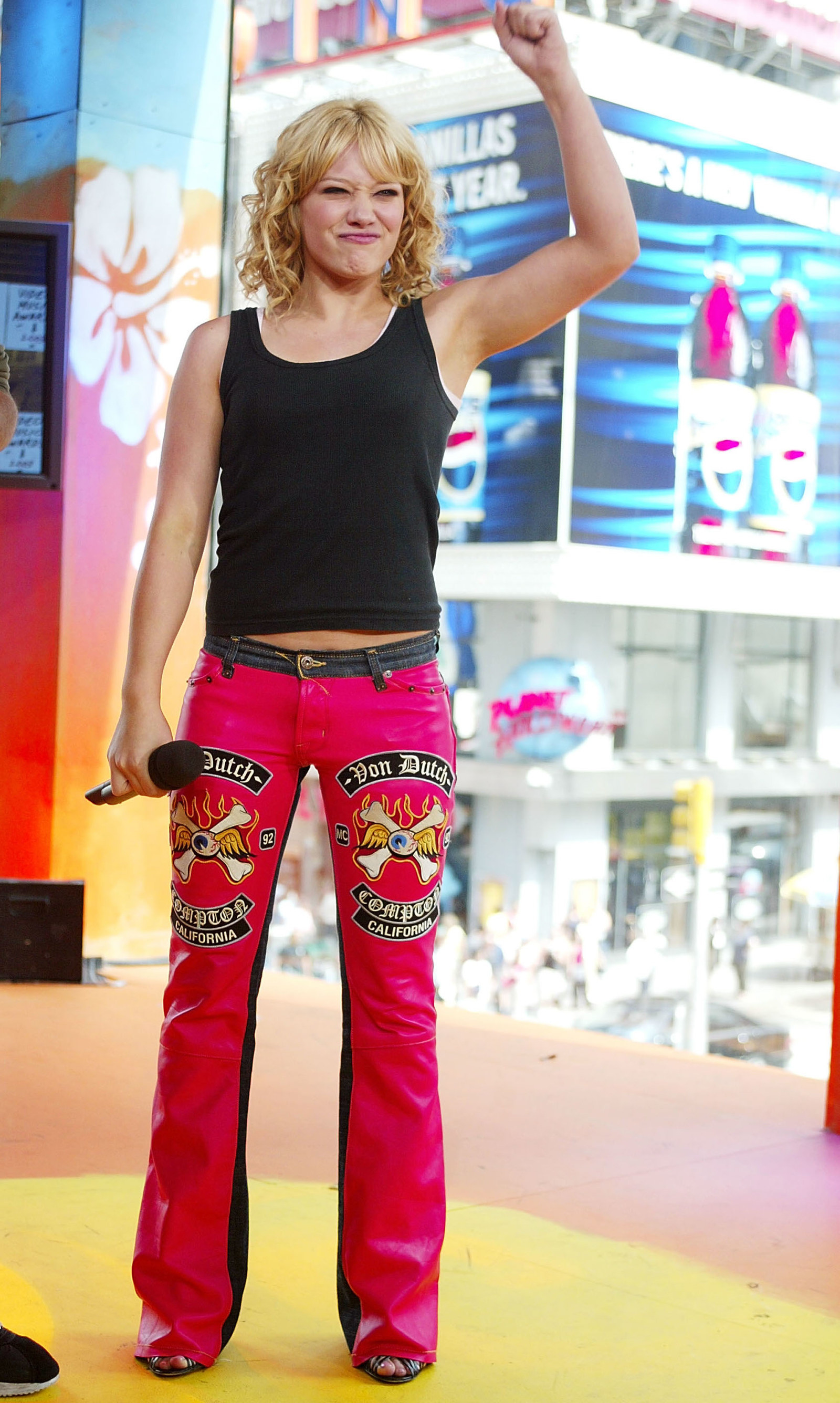 Hillary Duff literally wearing red leather Von Dutch pants.