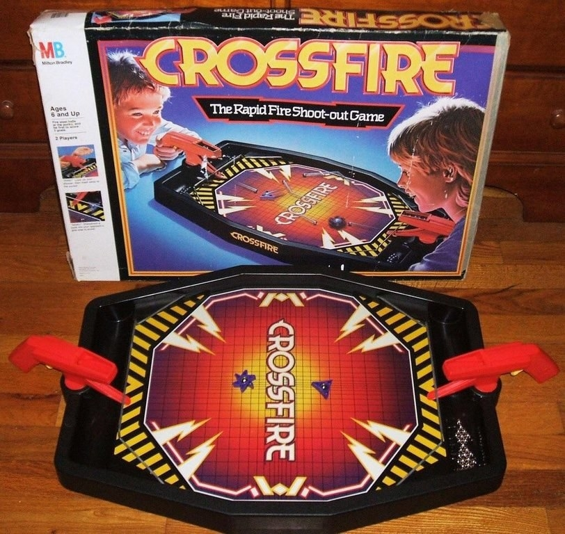 A up shot of the Crossfire board game alone with the box for it in the background