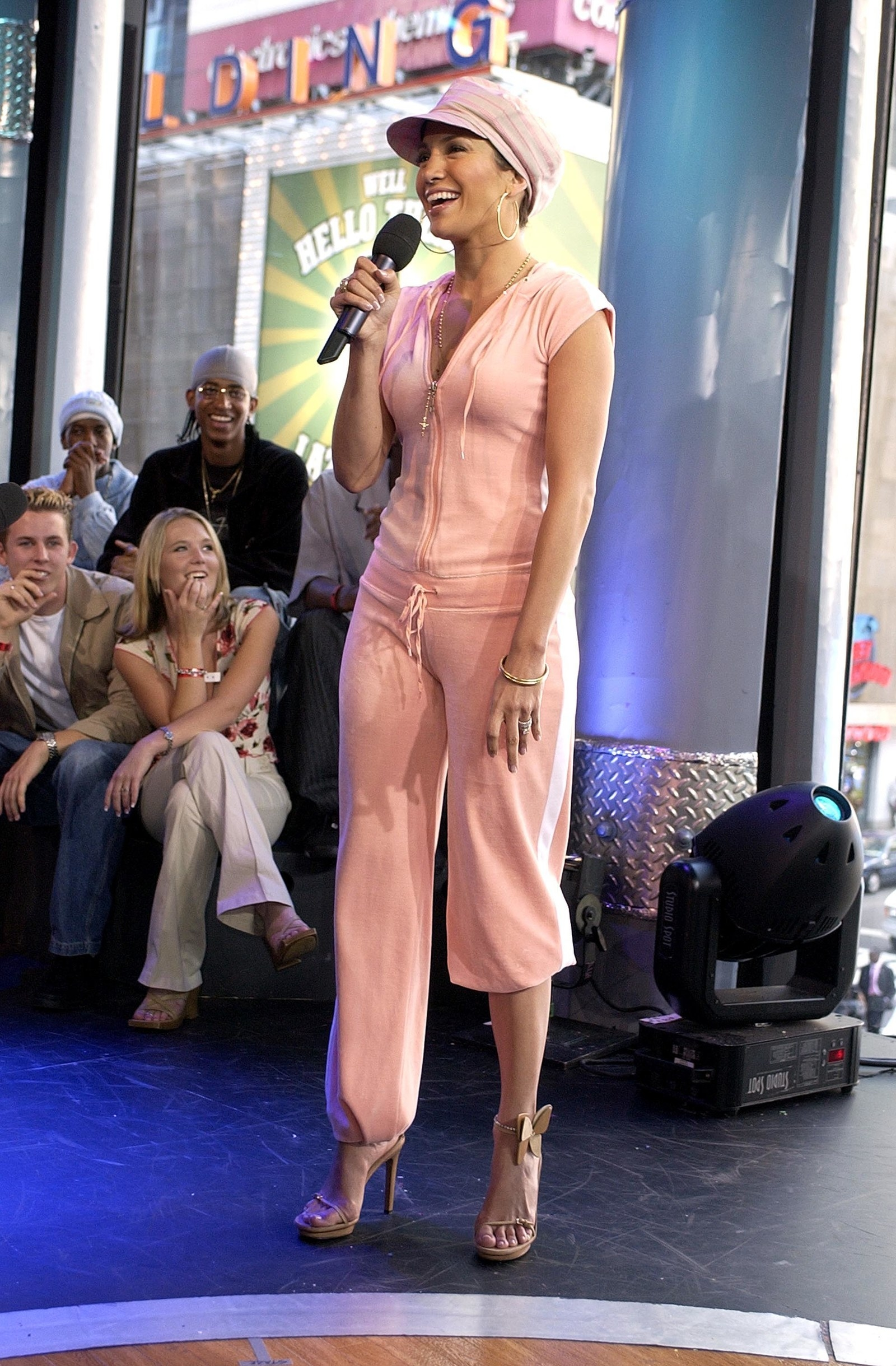 Jennifer Lopez an a literal head 2 toe pink velour tracksuit, with one leg rolled up cause that was cool.