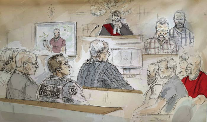 McArthur, center, attends his sentencing hearing in Toronto on Monday.