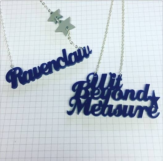 Get Ravenclaw, Hufflepuff, Gryffindor, or Slytherin from gemmipop on Etsy for $16.15 (each available as the name of the house or the associated traits).