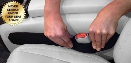 someone placing the product between the chair and the center console