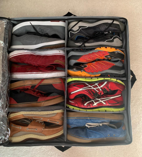 Oxfords, casual sneakers, and bright red running sneakers in cubes of gray eight-cell storage organizer on floor