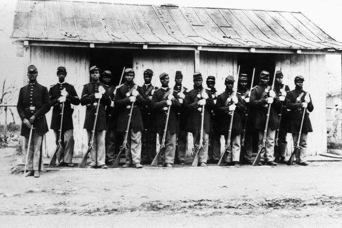 The 107th US Colored Infantry stand guard during the Civil War, circa 1865.