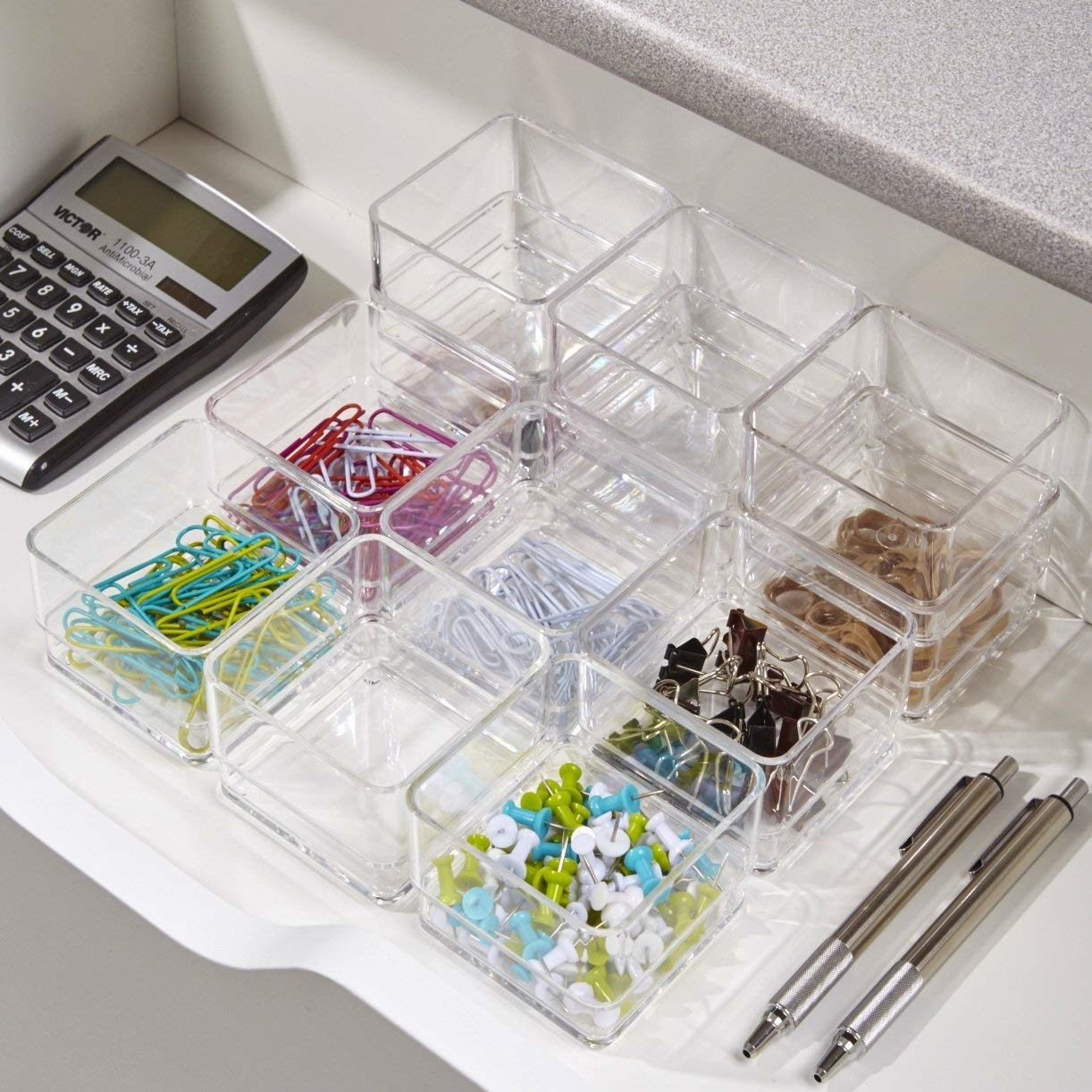 The cubes holding office supplies like push pins and paper clips