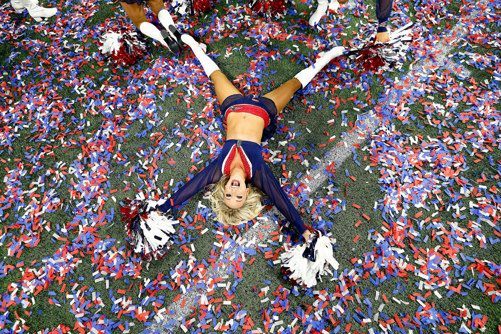 Mandatory Credit: Photo by LARRY W SMITH/EPA-EFE/REX/Shutterstock (10081952ps)A New England Patriots cheerleader lays on the field with graffiti after the New England Patriots defeated the Los Angeles Rams in Super Bowl LIII at Mercedes-Benz Stadium in Atlanta, Georgia, USA, 03 February 2019. Super Bowl LIII, Atlanta, USA - 03 Feb 2019