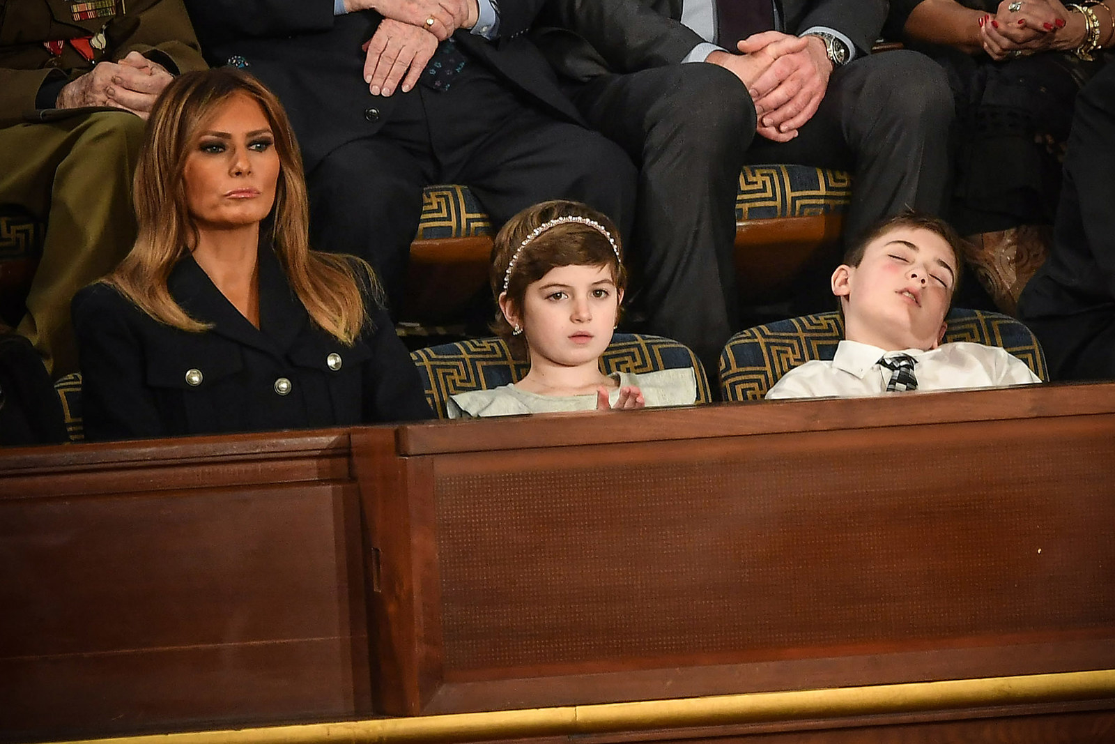 From left, First lady Melania Trump with Grace Eline, and Joshua Trump, special guests of President Donald Trump, watch the president give the State of the Union address on Feb. 5.