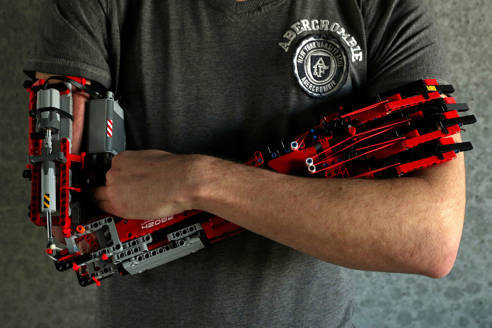 David Aguliar poses with his prosthetic arm built with Lego pieces during an interview with Reuters in Sant Cugat del Valles, near Barcelona, Spain, on Feb. 4.