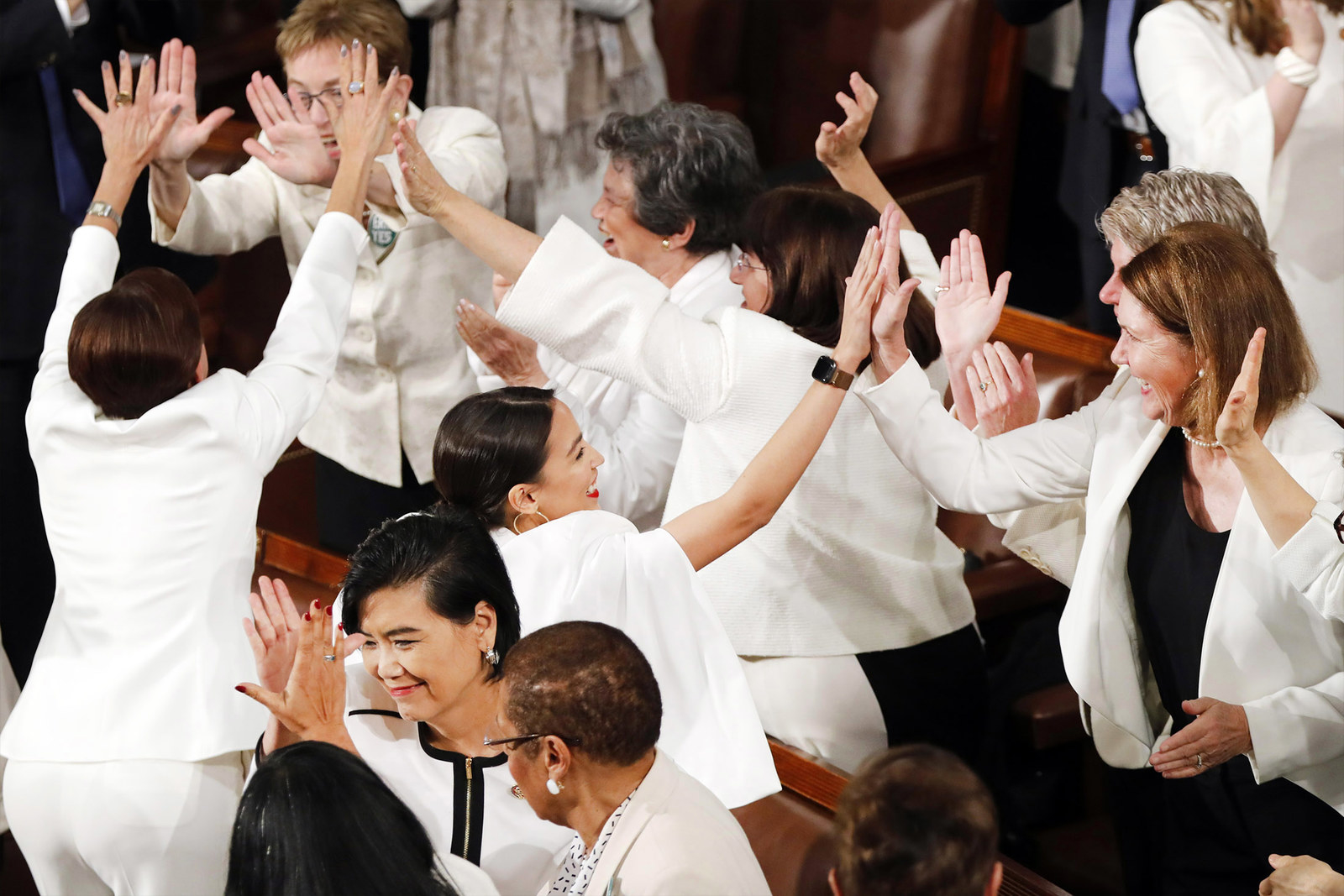 Women members of Congress cheer after President Donald Trump acknowledges more women in Congress during his State of the Union address on Feb. 5.