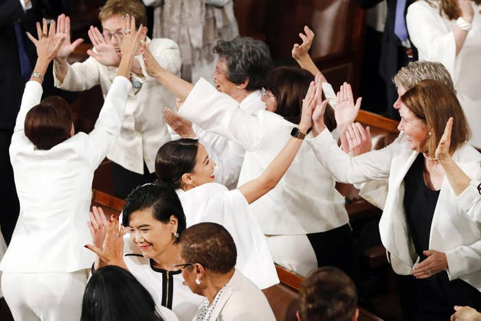 Women members of Congress cheer after Trump acknowledges more women in Congress during his State of the Union address on Feb. 5.