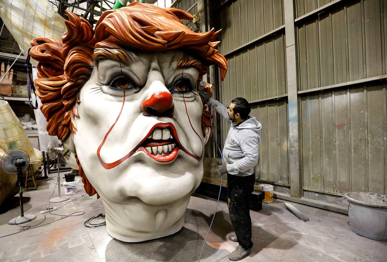 A worker gives final touches to a carnival float character depicting President Donald Trump during preparations of the 2019 Nice Carnival, in Nice, France, on Feb. 5.