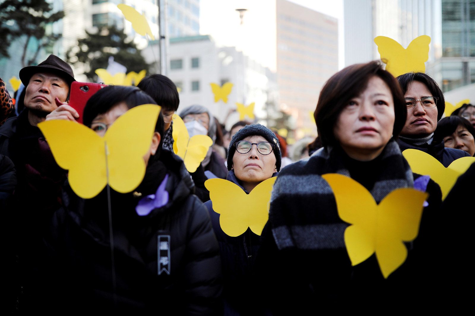 """People react as they hold yellow colored butterflies dedicated to former South Korean """"comfort woman"""" Kim Bok-dong during her funeral in Seoul, South Korea, on Feb. 1."""