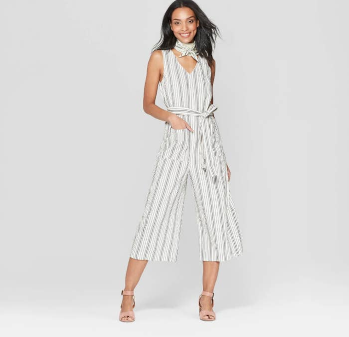 7ce308e805e17 A striped jumpsuit that seriously is too cute not to buy. Now that I've  seen this, I don't even know how my closet can live without it.