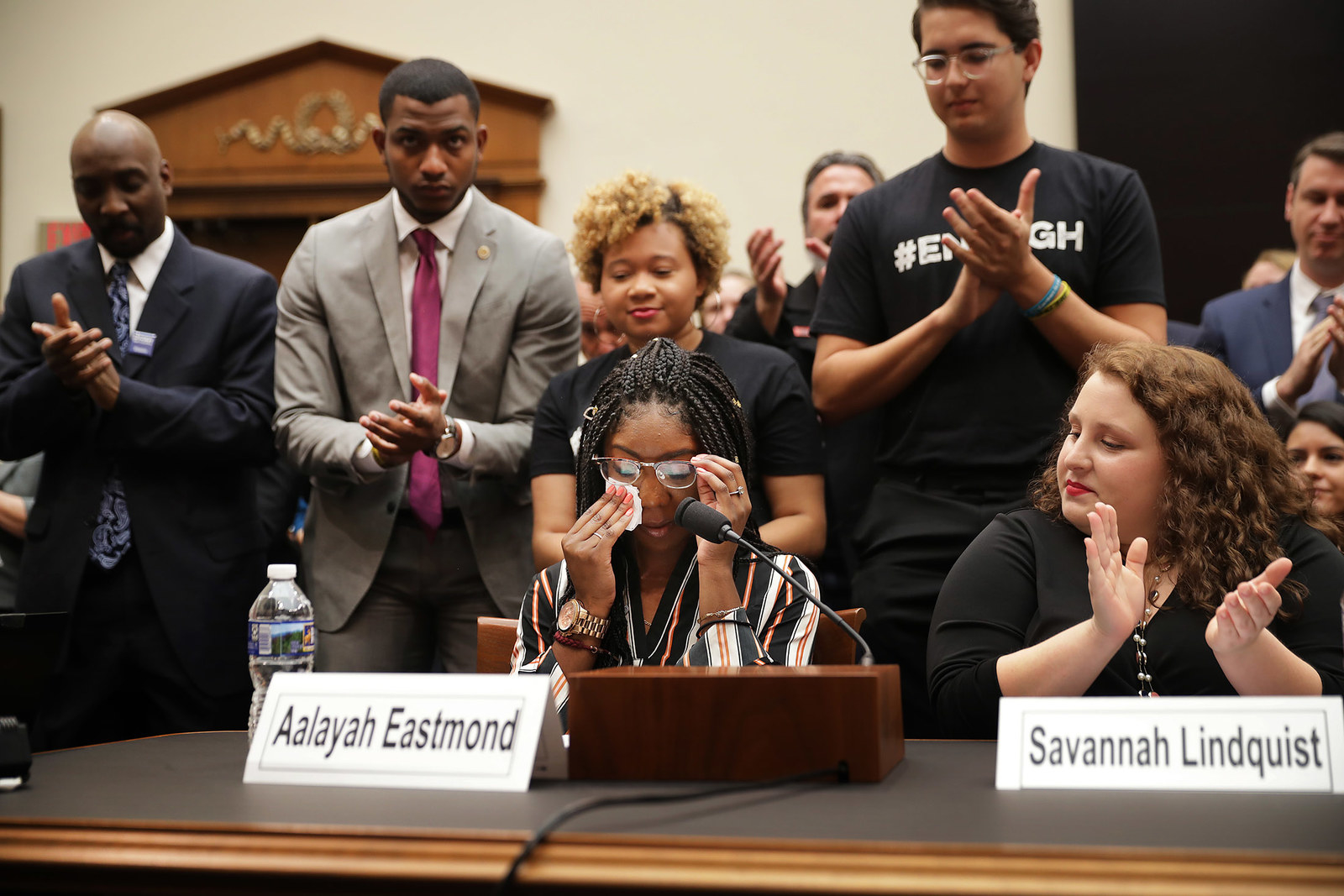 Aalayah Eastmond, center, a survivor of the mass shooting at Marjory Stoneman Douglas High School in Parkland, Florida, wipes away tears as she receives a standing ovation while testifying to the House Judiciary Committee on Feb. 6, in Washington, DC. The committee heard testimony from gun violence victims, a trauma doctor, law enforcement officials and others during the first hearing in the House of Representatives on gun violence in eight years.
