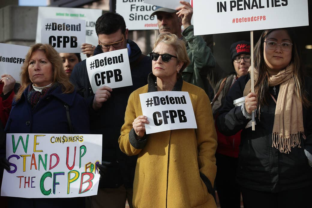 Protestors in front of the Consumer Financial Protection Bureau office on Nov. 27, 2017, in Washington, DC, after Mick Mulvaney was appointed acting director.