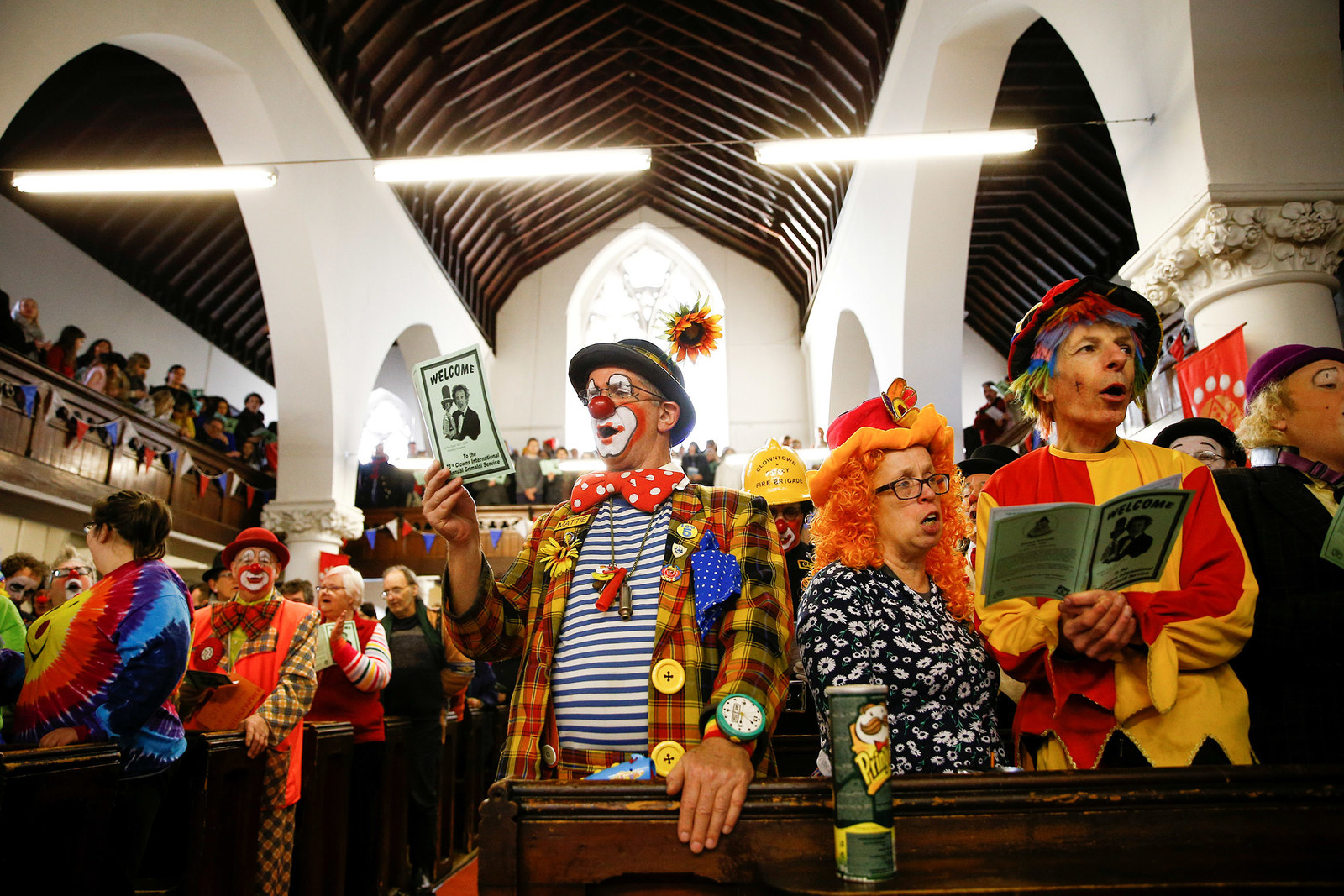 Clowns and entertainers gather to attend an annual service of remembrance in honor of British clown Joseph Grimaldi, at the All Saints Church in London on Feb. 3.
