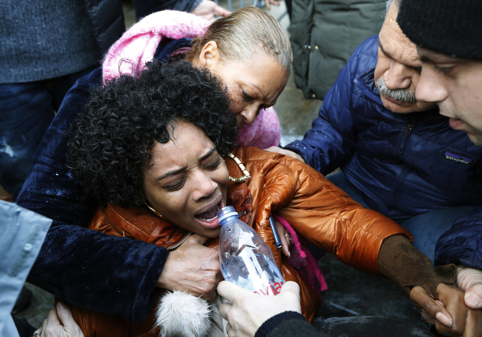 Yandy Smith is helped by others after being pepper sprayed on on Feb. 3, after she and others stormed the main entrance to the Metropolitan Detention Center in Brooklyn, New York, a federal prison where prisoners have gone without heat, hot water, and flushing toilets due to an electrical outage.