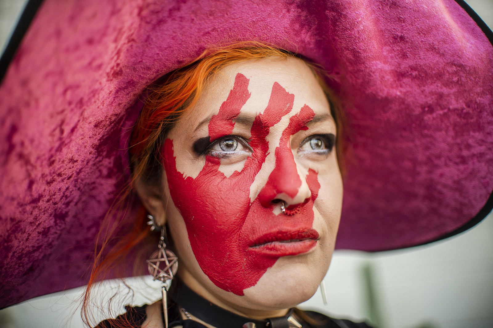 A woman with her face painted takes part in a protest against gender violence in Mexico City on Feb. 2.