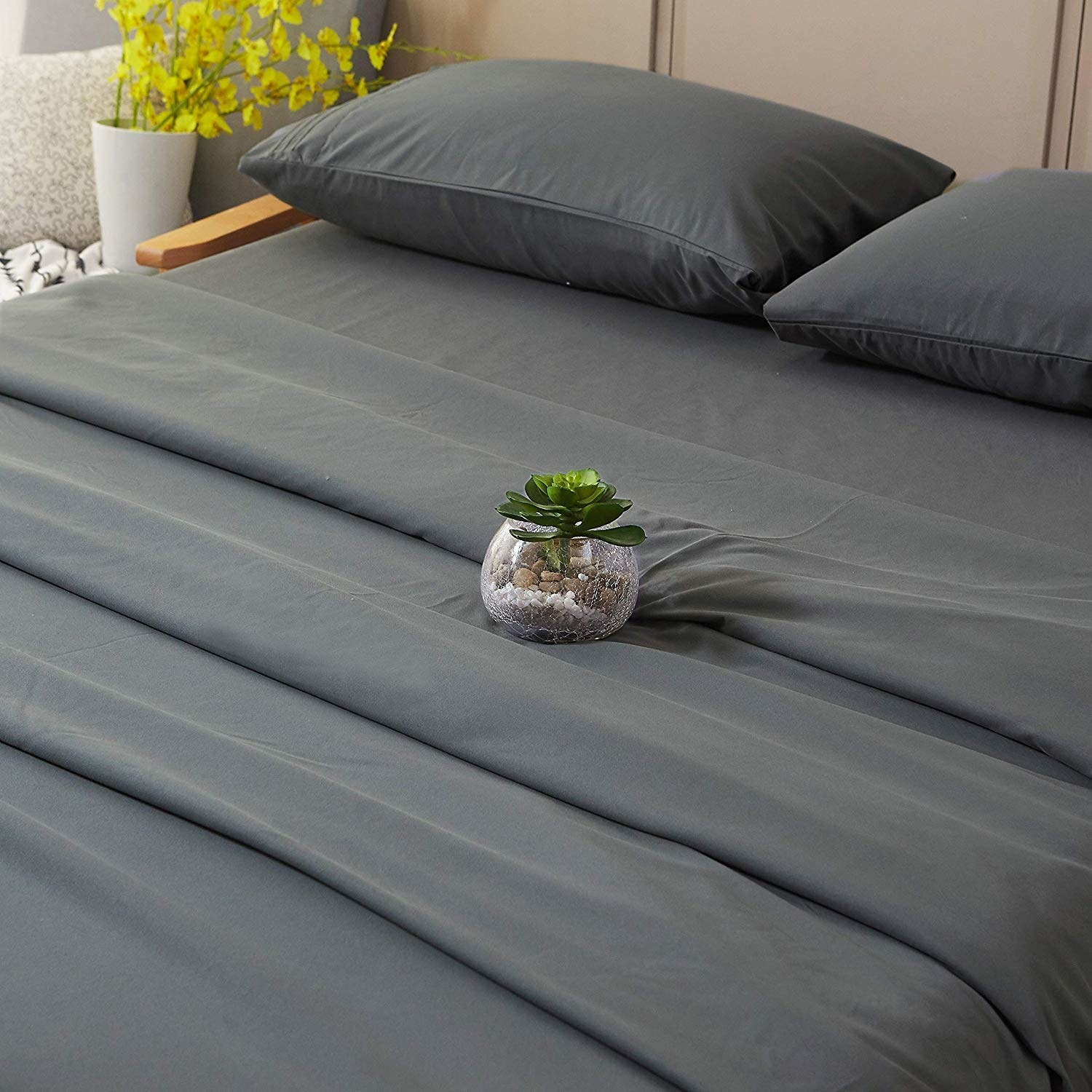 a grey sheet set with matching pillow cases