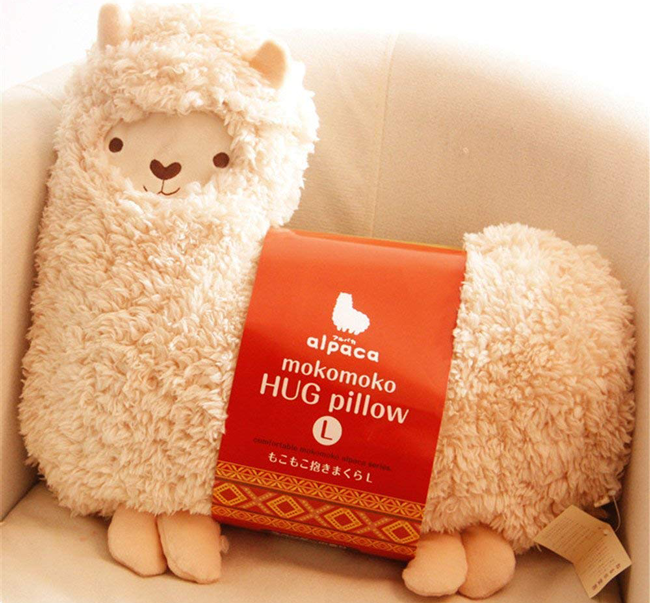 """Promising review: """"This is my new favorite cuddle pillow! It's so soft and the perfect size for hugging. The description says white but the cover is a light pink. I was happily surprised to see the cover completely comes off for washing! The Velcro is pretty thick, so this will last forever hopefully. I'm buying a second one just in case this one 'walks' away with one of my teenagers!"""" —ABBPrice: $27.99"""