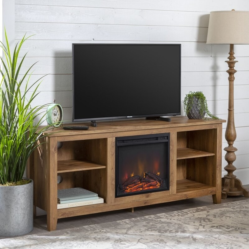 """Promising review: """"Love this stand! Exactly what I was looking for, and I'm surprised with how well it warmed up my living room and adjacent bedroom. Well worth the purchase."""" —NataleePrice: $209 (originally $499, available in seven finishes)"""