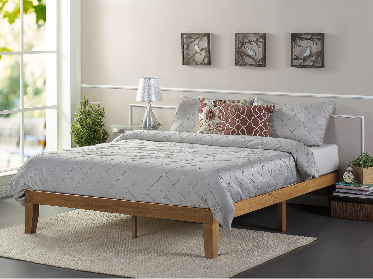 """Promising review: """"Great simple design and a breeze to put together. Sturdier than I thought it would be. Fits in nicely with my decor. Needed something without a head board but still beautiful all the way around. I like it so far and would recommend for small spaces."""" —cinnamongirlPrice: $119+ (available in sizes twin-king and three finishes)"""