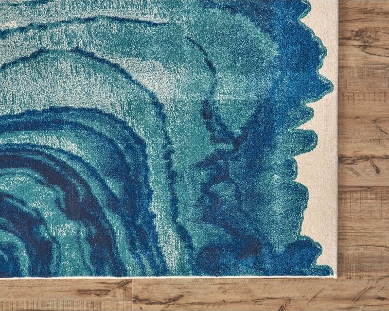 """Promising review: """"The colors are exactly as they appear on the site. The fibers are soft and plush. If you have a room where this unusual rug will work, don't hesitate. Buy it!"""" —KimPrice: $86.61+ (originally $233+, available in four sizes)"""